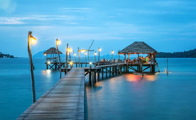 Beach bungalow at end of ocean jetty stock image