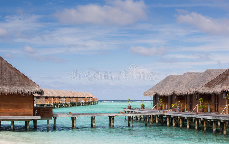 Beach bungalow and water villa royalty free stock photography