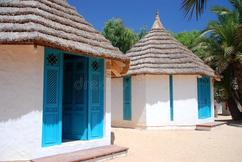 Beach bungalows in a touristic resort. Djerba, Tunisia. Djerba is the largest island of North Africa, located in the Gulf of Gabes, off the coast of Tunisia stock photo