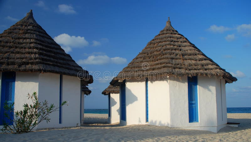 Beach bungalows in a touristic resort. Djerba, Tunisia. Djerba is the largest island of North Africa, located in the Gulf of Gabes, off the coast of Tunisia royalty free stock image