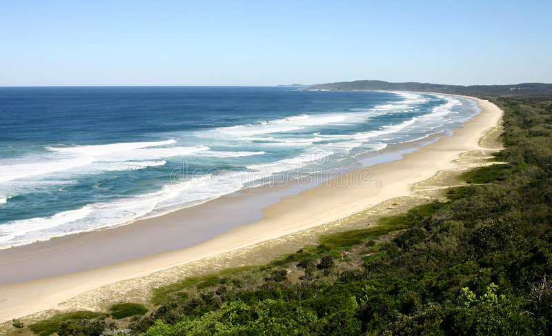 Beach - Byron Bay. Lonely beach at Cape Byron, Australia's most easterly point - Byron Bay, New South Wales, Australia stock photo