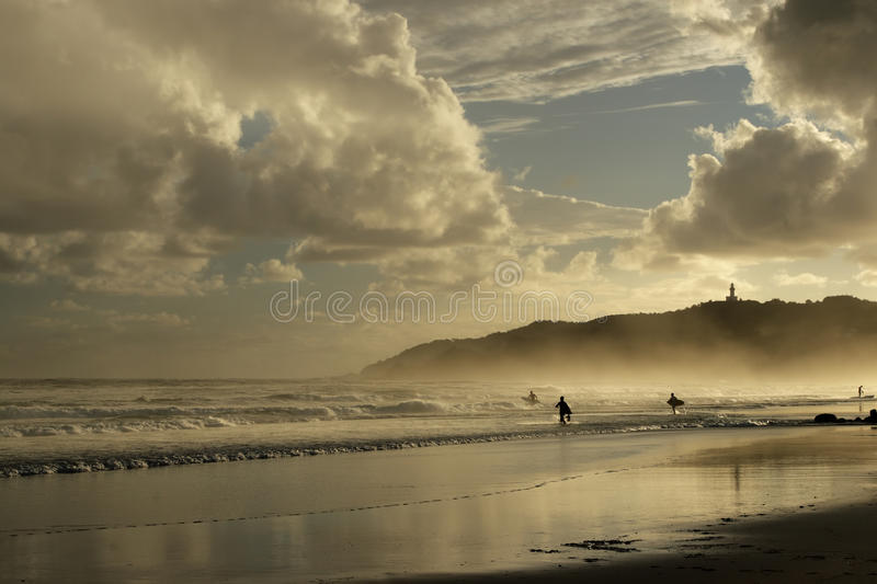 Beach of Byron Bay, Australia. At early morning with the lighthouse in the background royalty free stock image