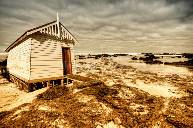 Beach cabin. On shore with ominous skies royalty free stock images