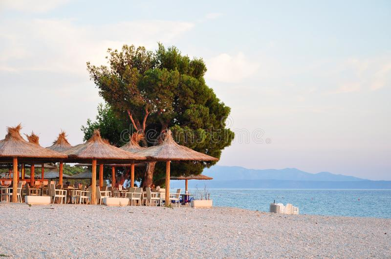Beach cafe. Adriatic beach cafe in croatia at sunset royalty free stock photos