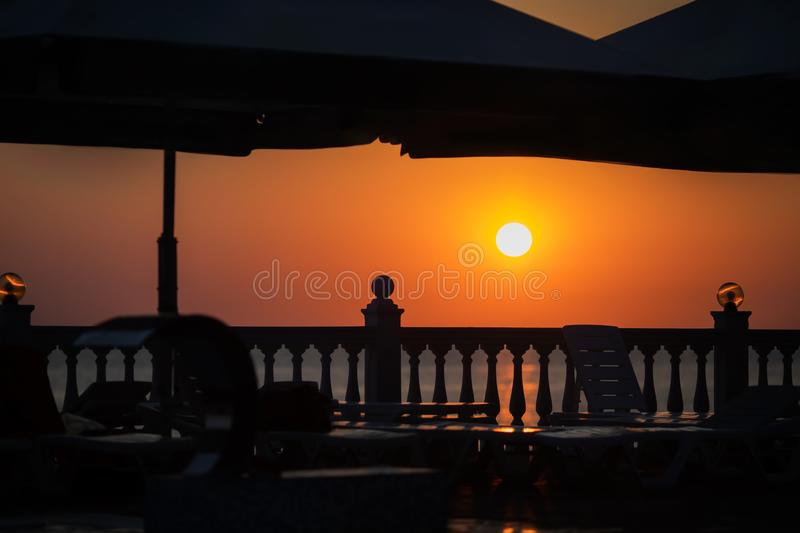 Beach cafe silhouette at the sunset, tropical resort, sea coast at the background royalty free stock images