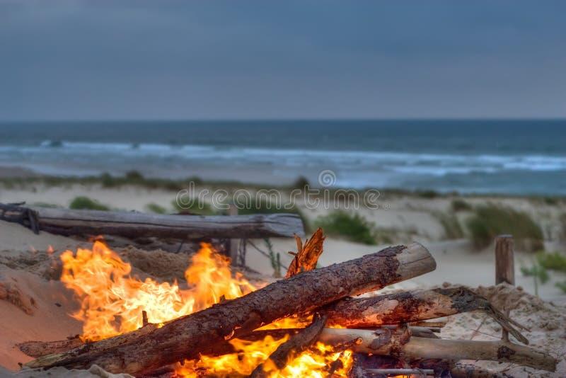 Beach campfire stock photos