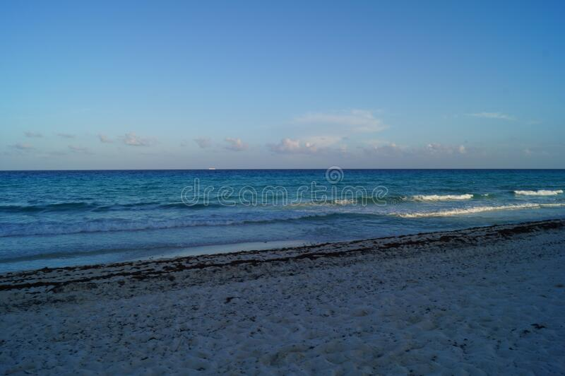 The beach in Cancun, Mexico. Cancun is a city in southeastern Mexico on the northeast coast of the Yucatan Peninsula in the Mexican state of Quintana Roo royalty free stock image
