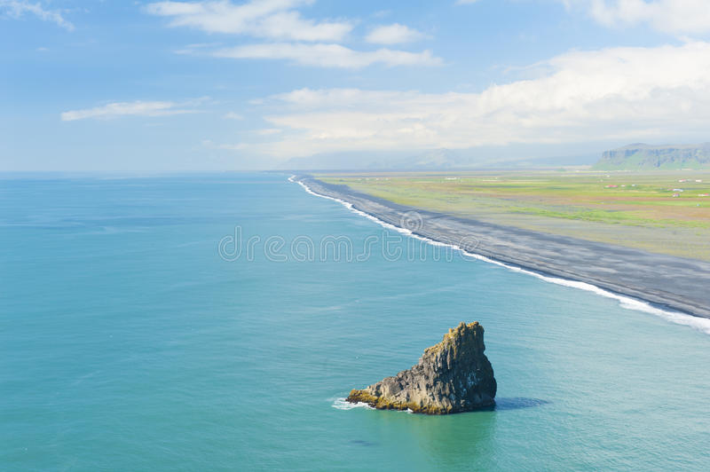 Beach from cape Dyrholaey. Black sandy beach seen from the cliff at the cape Dyrholaey, the most southern point of Iceland royalty free stock photography