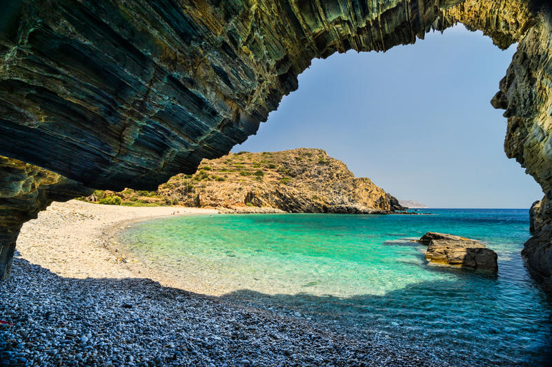 Beach with Cave. Well known beautiful Almiro beach with a cave at the Mani Peninsula on Peloponnese, Greece