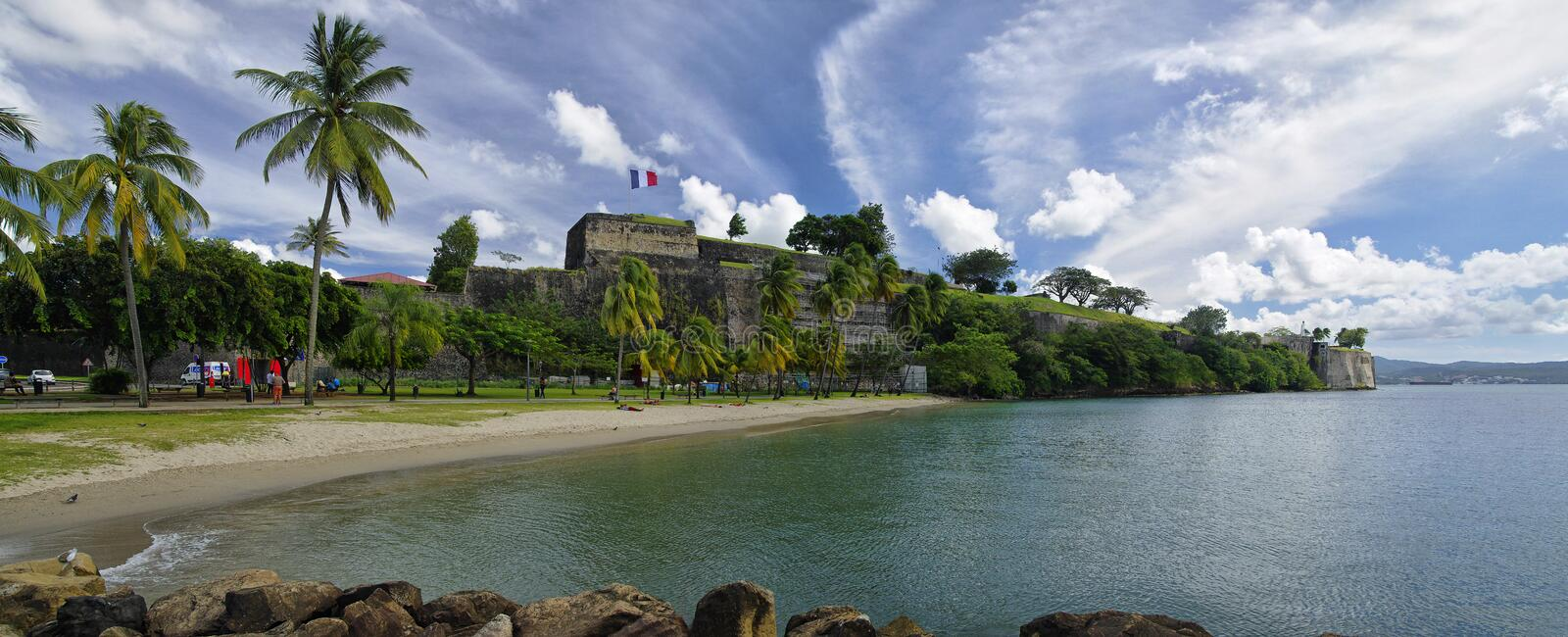 The beach in center of Fort de France near walls of Fort Saint Louis. Fort de Franc stock image