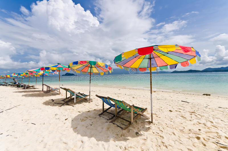 Beach chair and colorful umbrella on the beach. In sunny day, Phuket Thailand stock photos