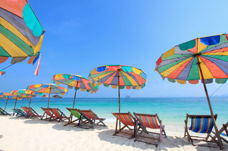 Beach chair and colorful umbrella on the beach. Phuket Thailand royalty free stock image