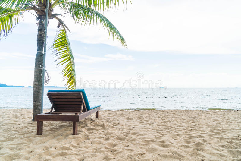 Beach chair, Palm and tropical beach at Pattaya in Thailand. Boost up color and lighting processing style stock images
