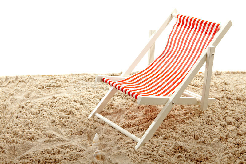 Beach chair on sand. Over white background stock images