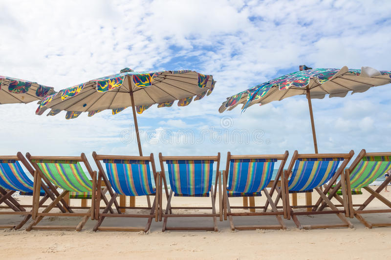 Beach and chair on sand beach. Concept for rest, relaxation, holidays, spa, resort. Illustrate general And add text stock photography