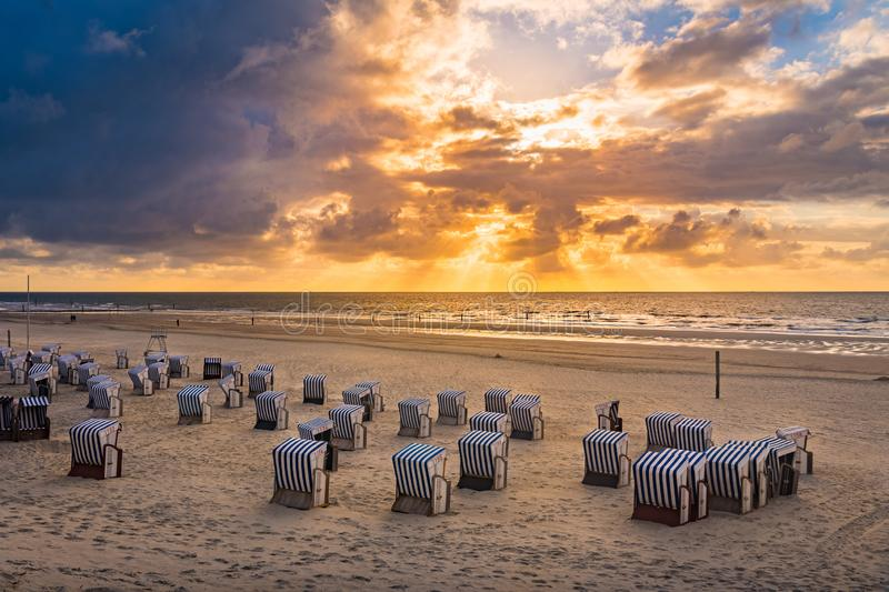 Beach chair on a sand beach. In Norderney, island of Germany stock images