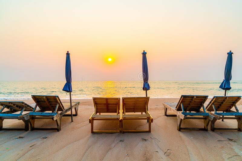 Beach chair on sand with ocean sea background. Empty beach chair on sand with ocean sea background stock photo