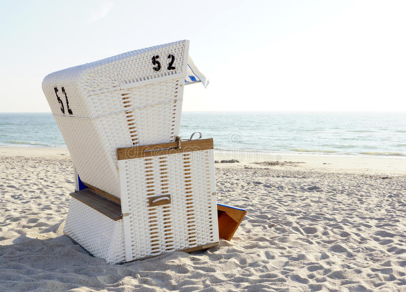 Beach Chair on sand at the ocean. Or sea in bright sunlight royalty free stock photos