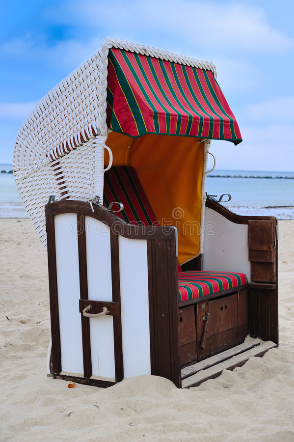 Beach chair (Strandkorb). A strandkorb (German, literally beach basket) is a special chair designed to provide comfort and protection from sun, wind, rain, and royalty free stock image