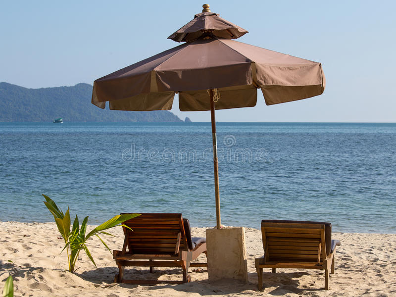 Beach chair and umbrella on the beach in sunny day , Thailand. Nature background stock images