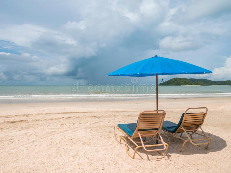 Beach Chair with Umbrella on the Beach. Two Beach Chair with Umbrella on the beach, weather condition is in Sunny Day. Location in Langkawi Malaysia royalty free stock photo