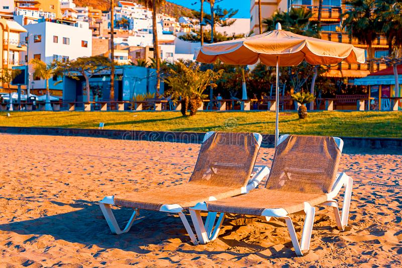 Beach chair with umbrella with blue sky on beautiful tropical beach,Relaxing time. Tenerife royalty free stock images