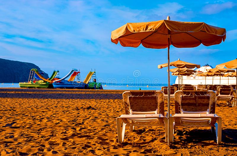 Beach chair with umbrella with blue sky on beautiful tropical beach,Relaxing time. Tenerife royalty free stock photos