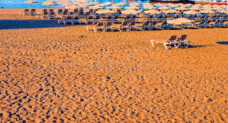 Beach chair with umbrella with blue sky on beautiful tropical beach,Relaxing time. Tenerife stock photography