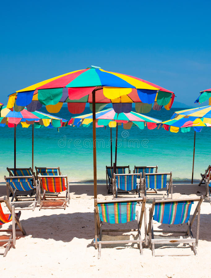 Beach chair under the umbrella of colorful on the beach Phuket, royalty free stock photos
