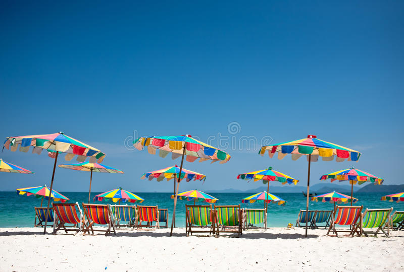 Beach chair under the umbrella of colorful on the beach Phuket,. Thailand stock photos