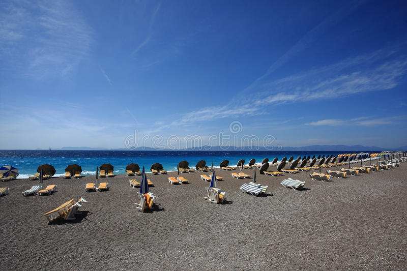 Beach chair under the umbrella of colorful stock image