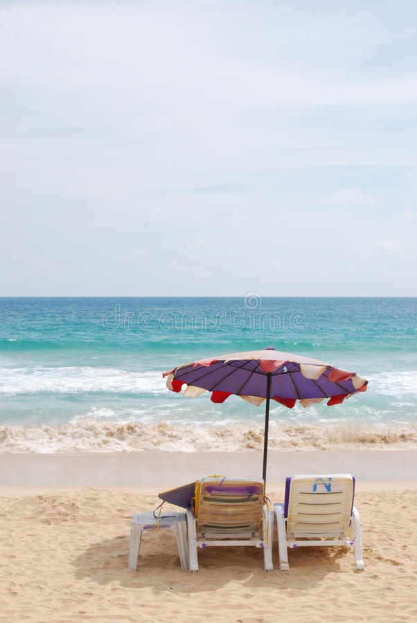 Beach chair and white umbrella on beach. Nai-Harn beach ,Phuket royalty free stock photography