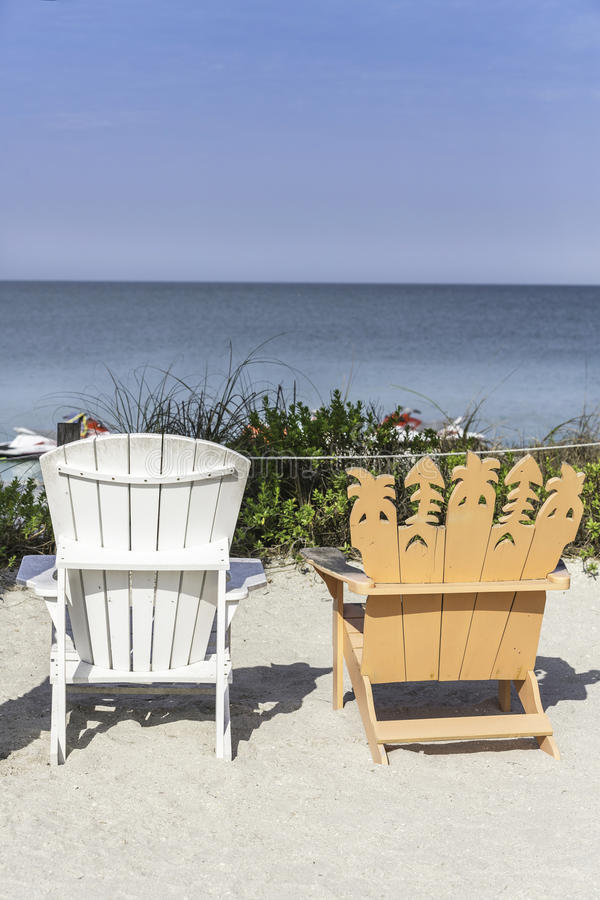 Beach chairs by the beach stock photography