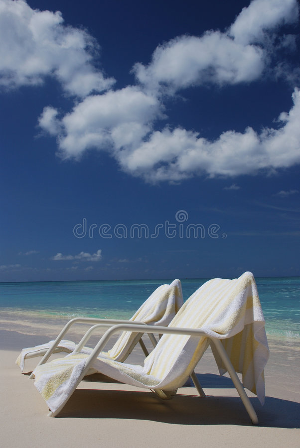 Beach chairs at Cayman Island. The Cayman Islands are a British overseas territory located in the western Caribbean Sea, comprising the islands of Grand Cayman stock photo