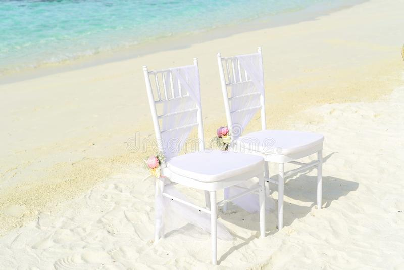 Beach, Chairs, Flowers royalty free stock photo