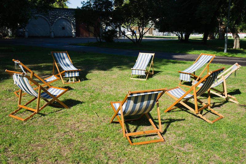 Beach chairs on the grass are waiting for a brainstorming work stock photo