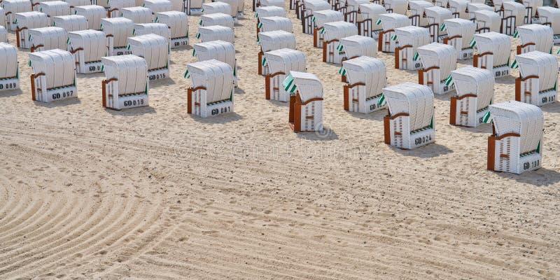 Beach chairs near Sellin Pier stock photography