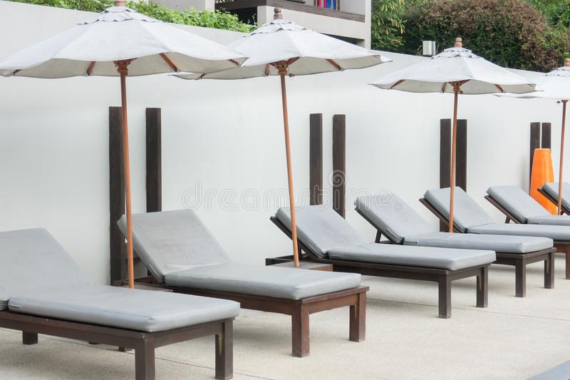 Beach chairs near swimming pool in hotel. royalty free stock photos