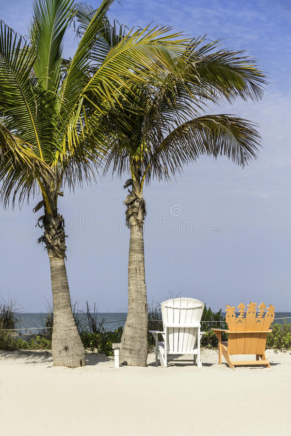 Beach chairs by the ocean royalty free stock photography