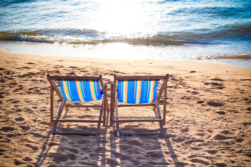 Pattaya beach. Couple of beach chairs on Pattaya beach in Thailand royalty free stock photography