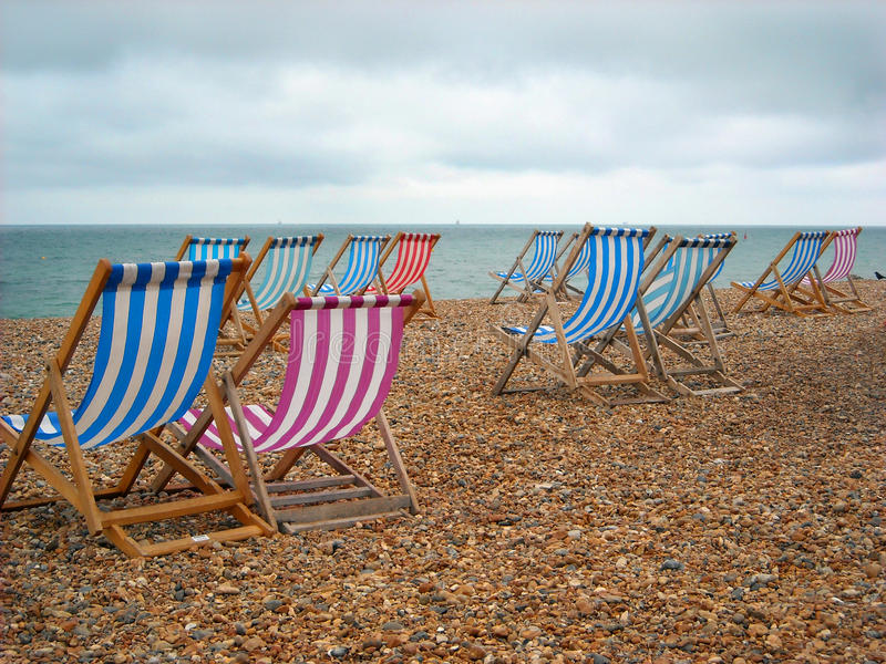 Download Beach Chairs On The Shore At Brighton England Stock Image - Image of stones, colored: 10563871