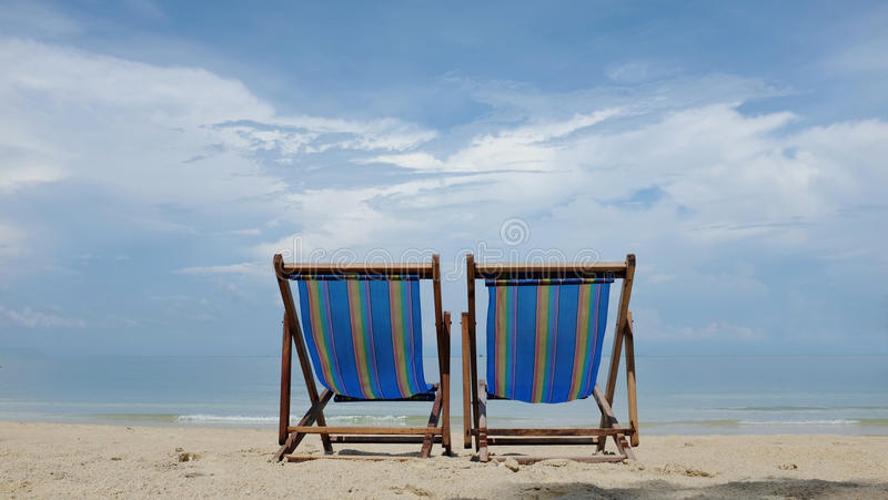 Beach chairs on tropical beach stock photo