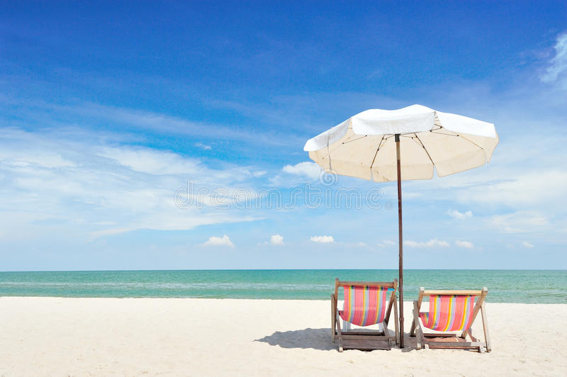 Beach chairs with umbrella. On a sunny day royalty free stock image