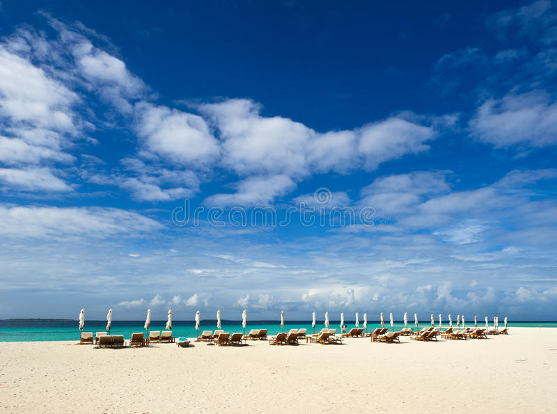 Beach chairs and umbrella on beach stock photo