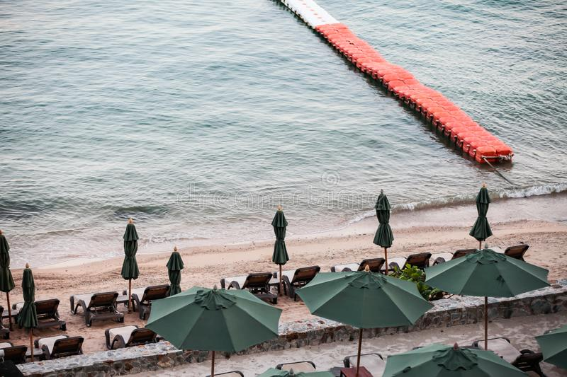 Beach chairs with umbrella outdoor swimming pool on the beach. Beautiful, bed, blue, exotic, hotel, infinity, island, lifestyle, luxury, nature, ocean royalty free stock photo