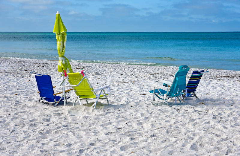 Beach Chairs with Umbrella. S on the Beach stock images