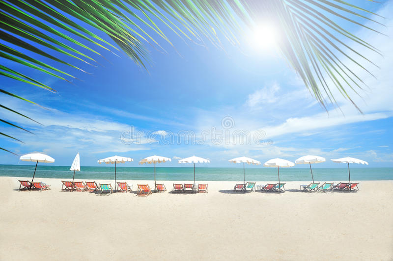Beach chairs with umbrellas. On a sunny day stock photos