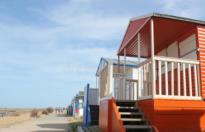 Beach Chalets. This photo shows a row of beach huts on Whitstable Beach promenade royalty free stock image