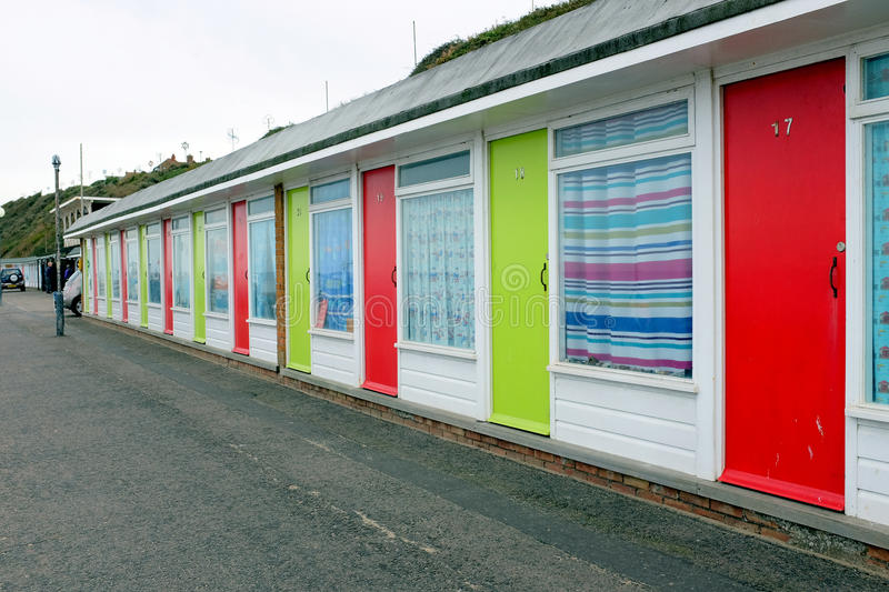 Beach Chalets. Cromer, Norfolk, UK. September 26, 2016. A line of colorful beach chalets on the promenade at Cromer stock photos