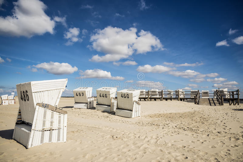 Download Beach Charis On Sand Beach In St. Peter-Ording Stock Photo - Image of clouds, cost: 30366624